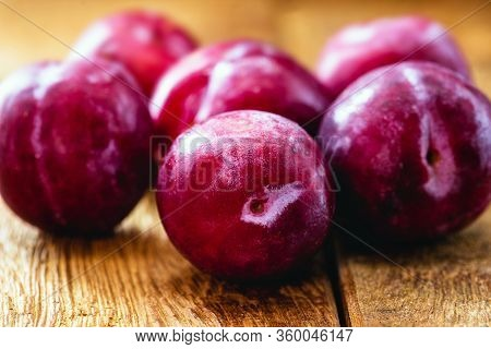 Brazilian Plum On Rustic Wooden Background, Image Of Tropical Fruit.