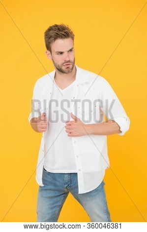 Man In White Shirt. Muscular Man In Jeans Yellow Background. Fashion And People Concept. Sexy And Ha