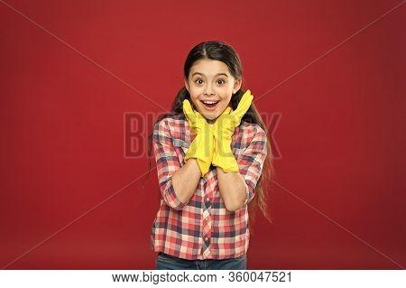 Happy Housekeeper. Little Housekeeper Wear Rubber Gloves Red Background. Small Girl Housekeeper. Hou