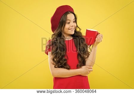 Girl Kid Hold Mug Yellow Background. Child Hold Mug. Drinking Tea Juice Cocoa. Relaxing With Drink.