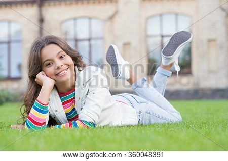 School Break For Rest. Adorable Pupil. Girl Kid Laying Lawn. Girl School Uniform Enjoy Relax. Import