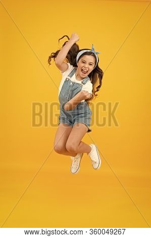 Totally Happy. Energy Inside. Feeling Free. Summer Holidays. Jump Of Happiness. Small Girl Jump Yell