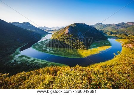 Picturesque scene of winding river Rijeka Crnojevica flowing through mountains. Location National park Skadar Lake, Montenegro, Balkans, Europe. Perfect wallpapers. Discover the beauty of earth.