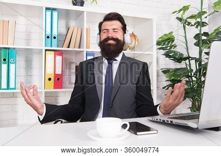 Technology For Mindful Meditation. Happy Employer Listen To Music In Office. Bearded Man Meditate Wi