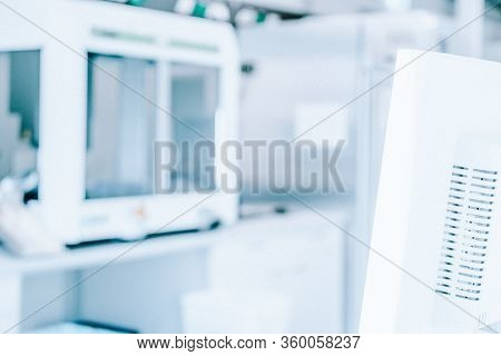 Blurred Laboratory Background With Roboter And Computer. Future Smart Laboratory And Scientific Back