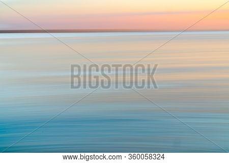 Beach Abstract High Horizon St Kilda Beach Back-lit By Setting Sun, Melbourne Australia.