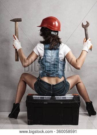 Sex Equality And Feminism. Back Of Sexy Girl Sitting On Toolbox Holding Wrench Spanner And Hammer. W
