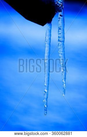 Icicle icicles hanging on Wood frozen during winter cold freezing water