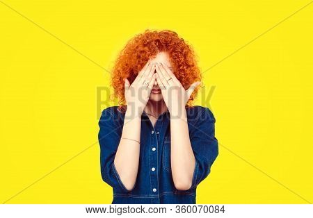 See No Evil Concept. Closeup Portrait Young Redhead Curly Hair Woman Closing Covering Eyes With Hand