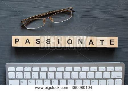 Modern Business Buzzword - Passionate. Top View On Wooden Table With Blocks. Top View. Close Up.