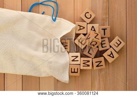 Cloth Bag And Wooden Cubes Top View. Wooden Cubes With Letters Of The English Alphabet, Educational