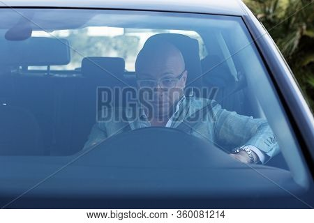 Shocked Scared Anxious Funny Looking Young Driver In The Car. Human Emotion Face Expression. Front W