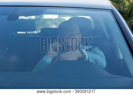 Shocked Scared Funny Looking Young Driver In The Car Talking On Phone. Human Emotion Face Expression