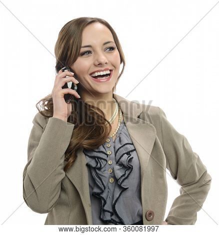 Young businesswoman talking on the cell phone smiling isolated on a white background