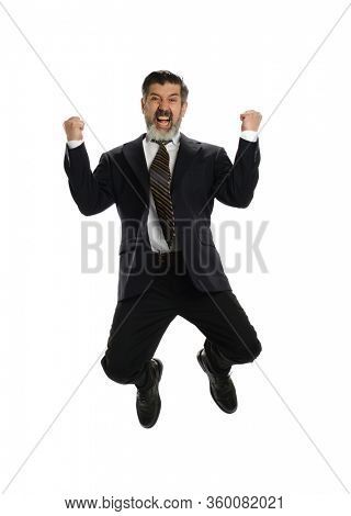 Mature hispanic businessman jumping of  joy isolaated on a white background