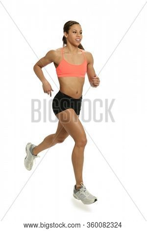 Young woman running isolated on a white background