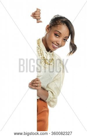Young black woman holding a blank sign isolated on a white backround