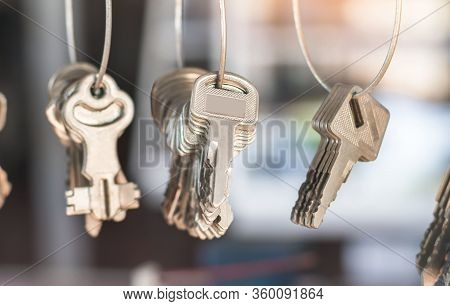 A Conceptual Image With Hanging Keys And One Shining Key. Many Key Chains For Copy Key On Locksmith