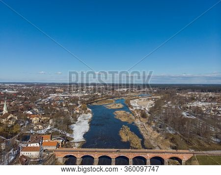 Areal Drove Photography View Of Old Classic Countryside City Kuldiga Brick Bridge In Europe. Photo T
