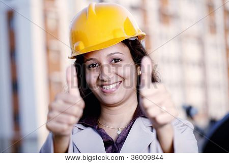 Happy Female Industrial Engineer With Thumbs Up