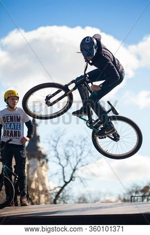 Lviv, Ukraine - March 12, 2020: Young Man Doing Tricks On A Bmx Bike. Bmx In The City Skatepark. Tee