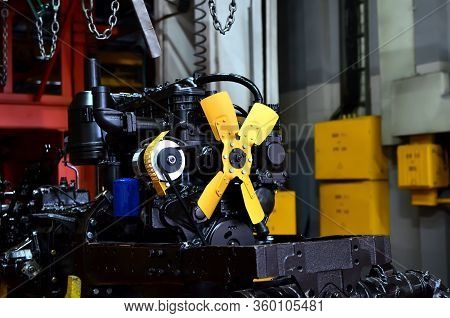 New Engines On Assembly Line Of Industrial Factory. Tractor Manufacture Work. Installation Of Parts