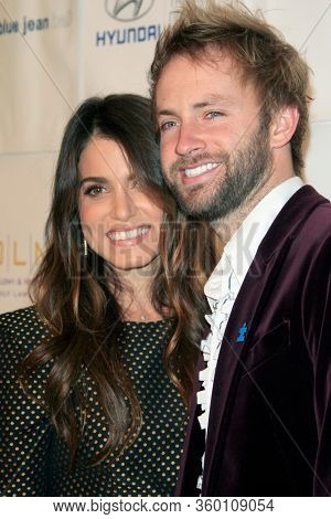 LOS ANGELES - NOV 26:  Nikki Reed, Paul McDonald at the Autism Blue Jean Ball at the Beverly Hilton Hotel on November 26, 2012 in Beverly Hills, CA12