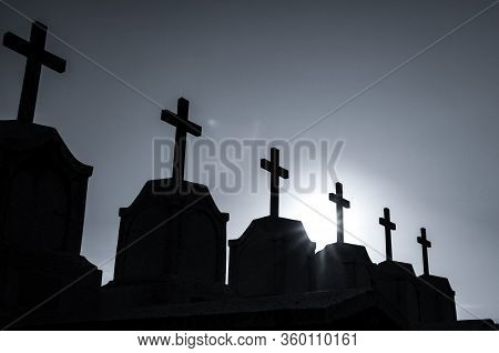 Cemetery Or Graveyard In The Night With Dark Sky. Headstone And Cross Tombstone Cemetery. Rest In Pe