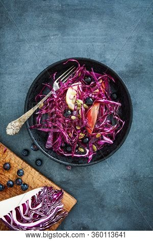Red cabbage with apples, blueberries and pumpkin seeds
