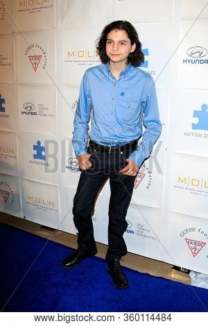 LOS ANGELES - NOV 26:  Max Burkholder at the Autism Blue Jean Ball at the Beverly Hilton Hotel on November 26, 2012 in Beverly Hills, CA12