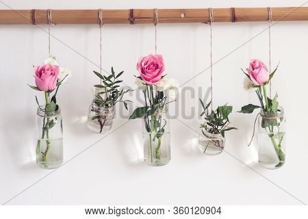 Reuse Glass Jars For Home Decor. Vertical Water Garden Of Hanging Flowers On White Wall. Feng Shui E