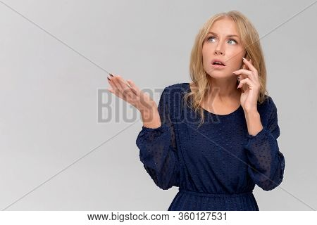 Headshot Of Shocked Millennial Woman Having Argument Talking Via Smartphone. Angry Young Female Spea