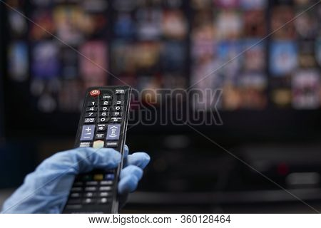 Watching Tv Or Online Video Streaming Service During Coronavirus Self-quarantine. A Person In Protec
