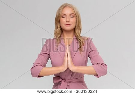 Girl Found Answers In Buddhism, Namaste. Portrait Of Relieved And Relaxed Attractive Woman, Smiling