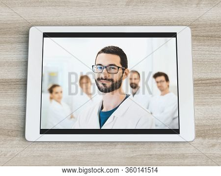 Healthcare, Profession, People And Medicine Concept - Smiling Male Doctor On Tablet