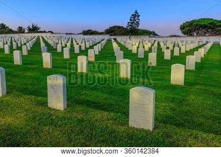 San Diego, California, United States - July 31, 2018: Cemetery Graveyard White Tombstones At Evening