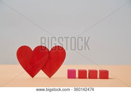 Love And Relationship. Valentines Day. Couple In Love. Amour, Fondness. Two Red Hearts, Wooden Cubes