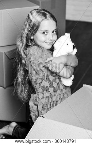 Small Child Prepare Toys For Relocation. Kid Girl Relocating Boxes Background. Relocating Concept. D