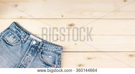 Blue Cotton Unisex Jeans Flat Lay On Wooden Background Top View With Copy Space For Text, Logo. Jean