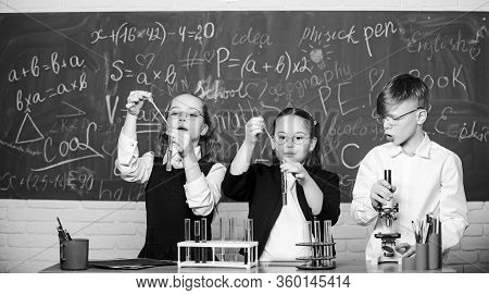 Study Of Liquid States. Group School Pupils With Test Tubes Study Chemical Liquids. Science Concept.