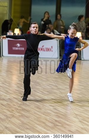 Riga, Latvia-december 15, 2019: Professional Adult Dance Couple Performs Juvenile Latin-american Pro