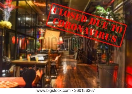Defocused, Blurred View Of Interior Of An Upmarket Bar Or Restaurant, Empty And Closed Due To Corona