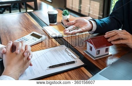 Sale Purchase Contract To Buy A House, Customer Sending Money Buying Home Loan And Giving Keys From