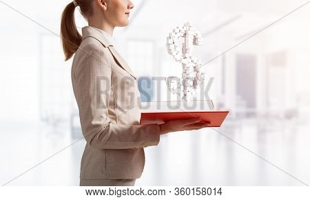 Businesswoman With Dollar Sign From Cubes Above Opened Notebook. Investment And Money Saving Service