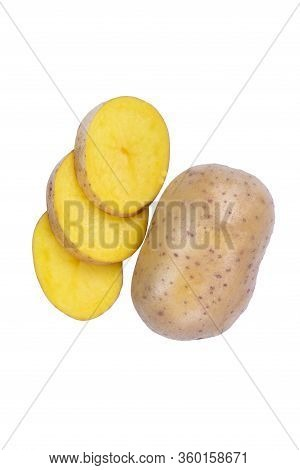 A Whole Potato And Perfectly Cut Pieces Full Of Nutritious Starch. Autumn Vegetables Isolated On Whi