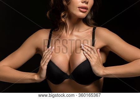 Cropped View Of Passionate Girl In Black Bra Touching Big Breasts Isolated On Black
