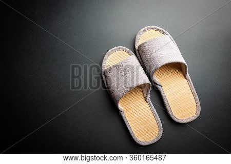 Comfortable Home Slippers On Black Background. Soft Comfortable Home Slipper. Stay At Home Concepts.