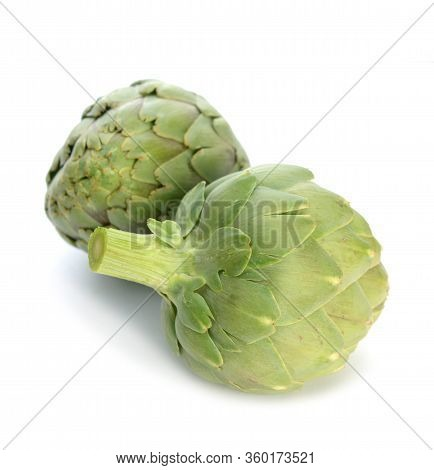 A Pair Whole Organic Artichoke On White Background