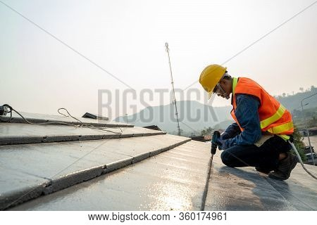 Construction Engineer Wear Safety Uniform Inspection Roofer Working On Roof Structure Of Building On