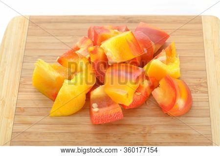Chopped Two Tone Bell Pepper  On Wooden Cutting Board